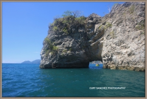A boat prepare's to sail through this natural tunnel on Tortuga Island off the Nicoya Peninsula in Costa Rica